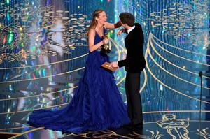 HOLLYWOOD, CA - FEBRUARY 28:  Actress Brie Larson (L) accepts the Best Actress award for 'Room' from actor Eddie Redmayne onstage during the 88th Annual Academy Awards at the Dolby Theatre on February 28, 2016 in Hollywood, California.  (Photo by Kevin Winter/Getty Images)