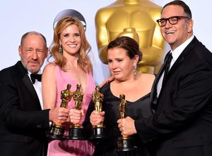 """(L-R) Steve Golin, Blye Pagon Faust, Nicole Rocklin, and Michael Sugar, pose with the Oscar for Best Picture, """"Spotlight,"""" in the press room during the 88th Oscars on February 28, 2016 in Hollywood.   AFP PHOTO/ROBYN BECKROBYN BECK/AFP/Getty Images"""