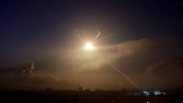 An Israeli forces flare lights up the sky of eastern Gaza City, early Wednesday, July 30, 2014, amid Israel's heaviest air and artillery assault in more than three weeks of Israel-Hamas fighting. (AP Photo/Khalil Hamra)