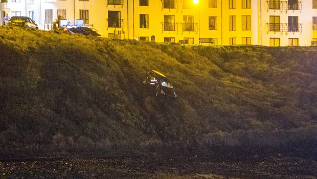The scene in Portballintrae where a car plunged over the cliff edge onto the beach. Picture: Steven McAuley/McAuley Multimedia