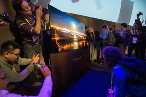 People look at the Bravia OLED television at the Sony Press Conference at the Sony Press Conference at CES at the 2017 Consumer Electronics Show in Las Vegas, Nevada, on January 4, 2017. / AFP PHOTO / DAVID MCNEWDAVID MCNEW/AFP/Getty Images