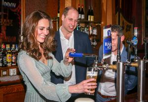 The Duke and Duchess of Cambridge pull pints of lager during a visit to the Empire Music Hall in Belfast in February 2019