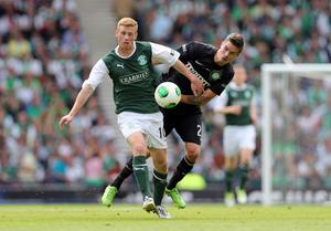 GLASGOW, SCOTLAND - MAY 26:  Eoin Doyle of Hibernian competes with Mikael Lustig of Celtic during the William Hill Scottish Cup Final match between Celtic and Hibernian at Hampden Stadium on May 26, 2013 in Glasgow, Scotland. (Photo by Ian MacNicol/Getty Images)