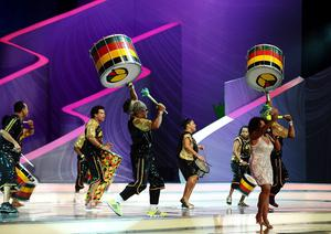 Dancers perform on stage during the FIFA 2014 World Cup Draw at the Costa Do Sauipe, Bahia, Brazil.