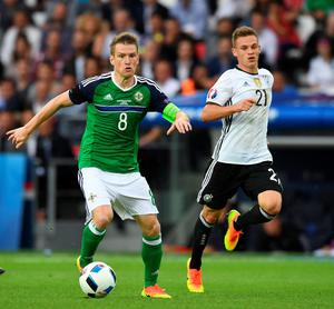 PARIS, FRANCE - JUNE 21: Steve Davis (L) of Northern Ireland and Joshua Kimmich (R) of Germany during the UEFA EURO 2016 Group C match between Northern Ireland and Germany at Parc des Princes on June 21, 2016 in Paris, France. (Photo by Charles McQuillan/Getty Images)
