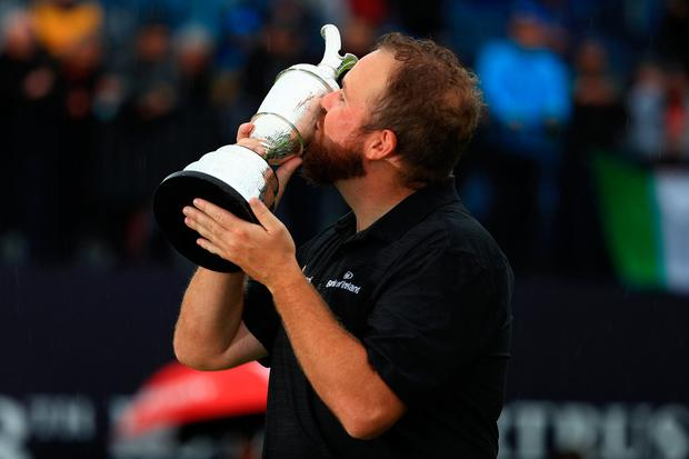 PORTRUSH, NORTHERN IRELAND - JULY 21: Open Champion Shane Lowry of Ireland celebrates with the Claret Jug on the 18th green during the final round of the 148th Open Championship held on the Dunluce Links at Royal Portrush Golf Club on July 21, 2019 in Portrush, United Kingdom. (Photo by Mike Ehrmann/Getty Images)