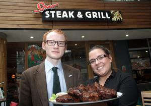 Pride at steak: Nevada Spur manager Lynsey Waring presents our man with his monstrously meaty challenge. Pic: Colm O'Reilly/Sunday Life.