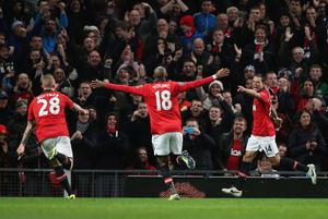 MANCHESTER, ENGLAND - OCTOBER 29:  Javier Hernandez (R) of Manchester United celebrates scoring his second goal during the Capital One Cup fourth round match between Manchester United and Norwich City at Old Trafford on October 29, 2013 in Manchester, England.  (Photo by Clive Brunskill/Getty Images)
