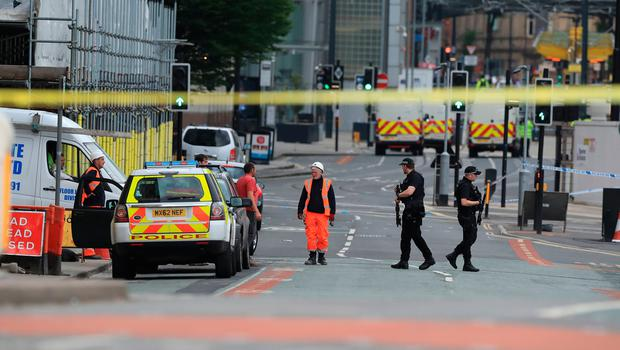 Police close to the Manchester Arena the morning after a terrorist attack at the end of a concert by US star Ariana Grande left 22 dead. PA