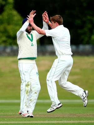 Over and out: Ireland's Craig Young, right, celebrates taking a wicket with Andrew Balbirnie