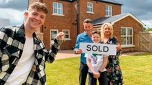Surprise purchase: YouTube star Adam Beales with mum Edelle, dad Paul and younger brother Callum outside the new house