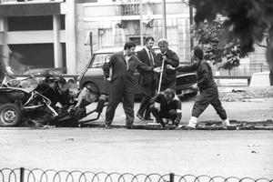 Police forensic officers working on the remains of the IRA car which housed the Hyde Park car bomb in 1982, in which four soldiers died, in Hyde Park, London.