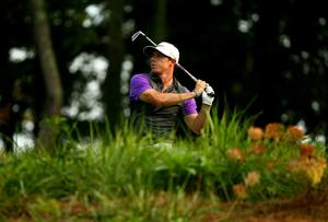 Rory McIlroy of Northern Ireland hits his tee shot on the 14th hole during the final round of the 96th PGA Championship at Valhalla Golf Club on August 10, 2014 in Louisville, Kentucky.  (Photo by Andy Lyons/Getty Images)
