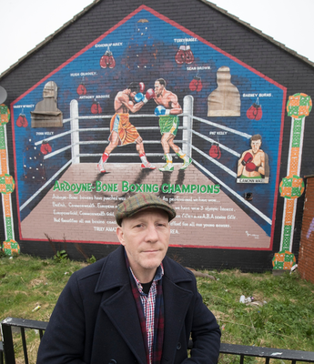 Magee pictured at a mural in his native Ardoyne dedicated to famous boxers from the area. Pic: Colm O'Reilly/Sunday Life.