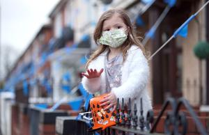 PACEMAKER, BELFAST, 2/4/2020: Four year old Juliet McAteer from the Whiterock Gardens area of Belfast beats her drum for the NHS and key workers who are at the front line in the fight against the Coronavirus pandemic in Northern Ireland at 8pm on Thursday night. PICTURE BY STEPHEN DAVISON