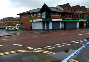Police seal off a large area after a device exploded under a car in east Belfast, leaving a man injured.