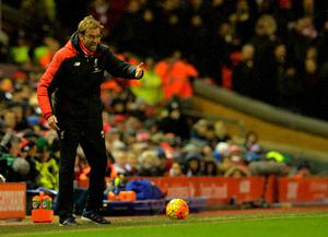 Liverpool's German manager Jurgen Klopp gestures during the English Premier League football match between Liverpool and Arsenal at Anfield stadium in Liverpool, north-west England on January 13, 2016. AFP PHOTO / PAUL ELLIS RESTRICTED TO EDITORIAL USE. NO USE WITH UNAUTHORIZED AUDIO, VIDEO, DATA, FIXTURE LISTS, CLUB/LEAGUE LOGOS OR 'LIVE' SERVICES. ONLINE IN-MATCH USE LIMITED TO 75 IMAGES, NO VIDEO EMULATION. NO USE IN BETTING, GAMES OR SINGLE CLUB/LEAGUE/PLAYER PUBLICATIONS.PAUL ELLIS/AFP/Getty Images