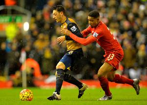 Arsenal's German midfielder Mesut Ozil (L) holds off Liverpool's English midfielder Jordon Ibe during the English Premier League football match between Liverpool and Arsenal at Anfield stadium in Liverpool, north-west England on January 13, 2016. AFP PHOTO / PAUL ELLIS RESTRICTED TO EDITORIAL USE. NO USE WITH UNAUTHORIZED AUDIO, VIDEO, DATA, FIXTURE LISTS, CLUB/LEAGUE LOGOS OR 'LIVE' SERVICES. ONLINE IN-MATCH USE LIMITED TO 75 IMAGES, NO VIDEO EMULATION. NO USE IN BETTING, GAMES OR SINGLE CLUB/LEAGUE/PLAYER PUBLICATIONS.PAUL ELLIS/AFP/Getty Images