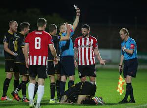 ©/Presseye.com - 4th October 2016.  Press Eye Ltd - Northern Ireland - Irish Daily Mail FAI Cup Semi-Final replay - Derry City V Dundalk  Derry's Rory Patterson booked by match refereeDavid McKeon.  Mandatory Credit Photo Lorcan Doherty / Presseye.com