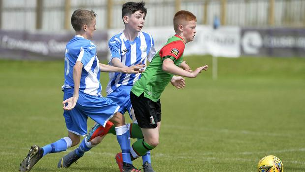 1st August 2019  Statsports Supercup NI 2019  Minor section semi final  match between Glentoran and Finn Harps at Seahaven in Portstewart. Glentorans Colby Smith in action with Finn Harps Adam McDaid Mandatory Credit : Stephen  Hamilton/Presseye