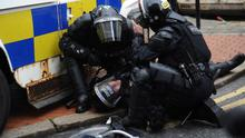 A police officer is injured amid serious loyalist rioting in Belfast city centre