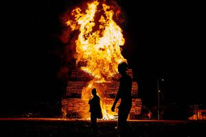 The 'eleventh night bonfire is lit at the Milner Street area of the Village in South Belfast as celebrations of William of Orange's victory commence on July 11th 2017 (Photo by Kevin Scott / Belfast Telegraph)