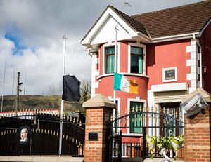 A black flag and the national flag of Ireland referred to as the Irish tricolour, fly at half mast at Connolly House, Andersonstown, Belfast following the death of Northern Ireland's former deputy first minister and ex-IRA commander Martin McGuinness aged 66.  Liam McBurney/PA Wire