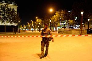 PARIS, FRANCE - APRIL 20:  Police officers secure the area after a gunman opened fire on Champs Elysees on April 20, 2017 in Paris, France. One police officer has been killed, and a second injured by a gunman on The Champs Elysees. Security is heightened in Paris with the first round of France's presidential election on Sunday. (Photo by Aurelien Meunier/Getty Images)