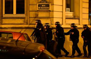 Police officers patrol near the site of a shooting at the Champs Elysees in Paris on April 20, 2017. French anti-terror prosecutors said they opened a probe today into the shooting on Paris's Champs Elysees that killed one police officer and wounded two others. France's interior ministry said the attacker was killed after opening fire on police in the early evening on the world-famous boulevard.  / AFP PHOTO / FRANCK FIFEFRANCK FIFE/AFP/Getty Images