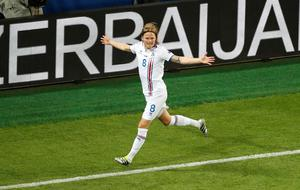 Iceland's Birkir Bjarnason celebrates scoring during the Euro 2016 Group F soccer match between Portugal and Iceland at the Geoffroy Guichard stadium in Saint-Etienne, France, Tuesday, June 14, 2016. (AP Photo/Michael Sohn)