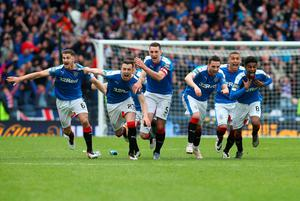 GLASGOW, SCOTLAND - APRIL 17:  Rangers players celebrate after winning the penalty shoot out during the Scottish Cup Semi Final between Rangers and Celtic at Hampden Park on April 17, 2016 in Glasgow, Scotland. (Photo by Ian MacNicol/Getty Images)