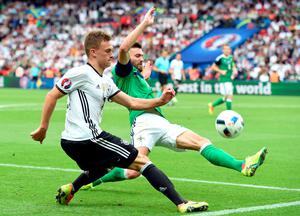 (LtoR) Germany's midfielder Joshua Kimmich and Northern Ireland's forward Kyle Lafferty vie for the ball during the Euro 2016 group C football match between Northern Ireland and Germany at the Parc des Princes stadium in Paris on June 21, 2016. / AFP PHOTO / PATRIK STOLLARZPATRIK STOLLARZ/AFP/Getty Images