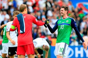 Northern Ireland's Kyle Lafferty (right) shakes hands with Germany goalkeeper Manuel Neuer after the final whistle during the UEFA Euro 2016, Group C match at the Parc Des Princes, Paris. PRESS ASSOCIATION Photo. Picture date: Tuesday June 21, 2016. See PA story SOCCER N Ireland. Photo credit should read: Jonathan Brady/PA Wire. RESTRICTIONS: Use subject to restrictions. Editorial use only. Book and magazine sales permitted providing not solely devoted to any one team/player/match. No commercial use. Call +44 (0)1158 447447 for further information.