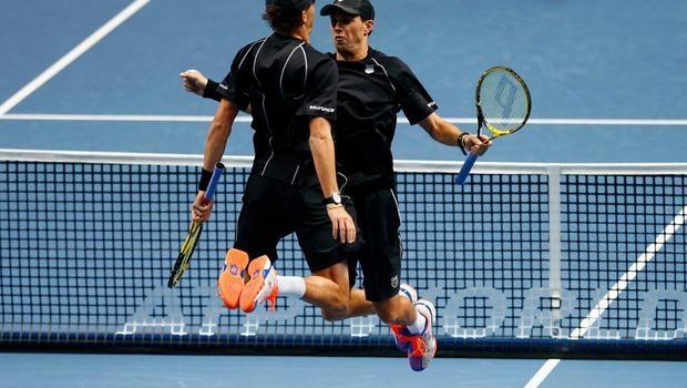 Bob Bryan of the United States and Mike Bryan of the United States celebrate match point in the doubles semi-final match against Julien Benneteau of France and Edouard Roger-Vasselin of France on day seven of the Barclays ATP World Tour Finals at O2 Arena on November 15, 2014 in London, England.  (Photo by Julian Finney/Getty Images)