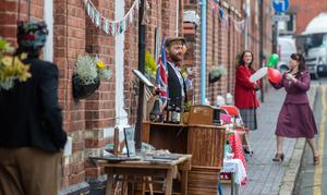 The residents of Cambrian Road in Chester dress up in 1945 clothing and have a social distancing tea party to mark the 75th anniversary of VE Day. PA Photo. Picture date: Friday May 8, 2020. Although large-scale public events are unable to go ahead because of coronavirus retrictions, tributes will be paid by politicians and members of the royal family, as well as through a host of other events as the nation remembers those who fought and died in the Second World War. Photo credit should read: Peter Byrne/PA Wire