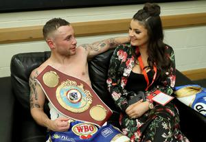 Carl Frampton with his wife Christine after defeating Nonito Donaire to win the WBO Interim featherweight title at the SSE Arena, Belfast on Saturday night.