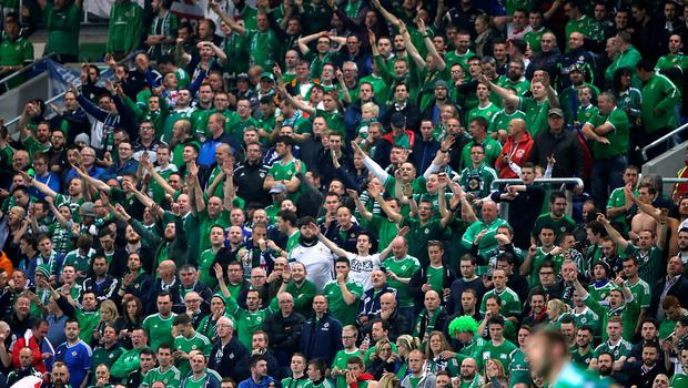 Northern Ireland fans in the stands during the UEFA European Championship Qualifying match at Windsor Park, Belfast. PRESS ASSOCIATION Photo. Picture date: Thursday October 8, 2015. See PA story SOCCER N Ireland. Photo credit should read: Niall Carson/PA Wire.