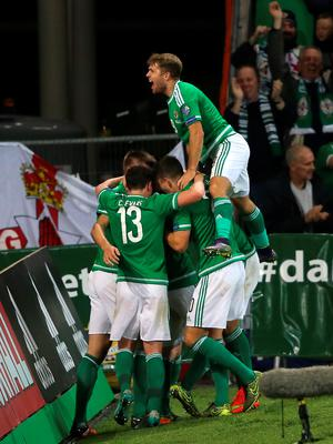 Northern Ireland's Steven Davis celebrates scoring his side's third goal of the match with teammates during the UEFA European Championship Qualifying match at Windsor Park, Belfast. PRESS ASSOCIATION Photo. Picture date: Thursday October 8, 2015. See PA story SOCCER N Ireland. Photo credit should read: Niall Carson/PA Wire.