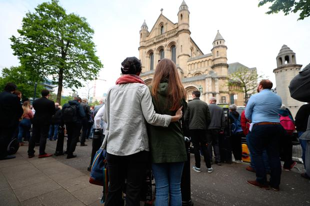 Mourners listen to the funeral service of murdered journalist Lyra McKee outside St Anne's Cathedral in Belfast. PRESS ASSOCIATION Photo. Picture date: Wednesday April 24, 2019. Miss McKee, 29, died as a result of injuries sustained when she was shot on the Creggan estate on April 18. See PA story FUNERAL McKee. Photo credit should read: Liam McBurney/PA Wire