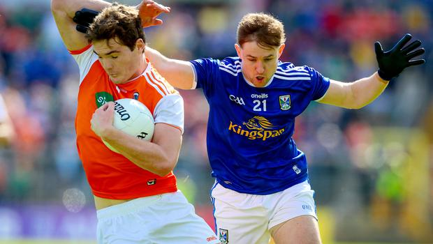 Cavan's Stephen Murray with Jarlath Og Burns of Armagh. Credit: INPHO/Tommy Dickson
