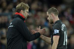 Liverpool's English midfielder Jordan Henderson (R) shakes hands with Liverpool's German manager Jurgen Klopp (L) as he leaves the field after being substituted during the English Premier League football match between Sunderland and Liverpool at the Stadium of Light in Sunderland, north east England, on December 30, 2015. AFP PHOTO / OLI SCARFF  RESTRICTED TO EDITORIAL USE. No use with unauthorized audio, video, data, fixture lists, club/league logos or 'live' services. Online in-match use limited to 75 images, no video emulation. No use in betting, games or single club/league/player publications.OLI SCARFF/AFP/Getty Images