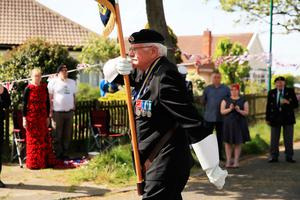 Local Royal British Legion branch chairman, Eric Howden, 75, carries his standard in Redcar, in North Yorkshire, where local residents held a two minute silence to mark the 75th anniversary of VE Day. PA Photo. Picture date: Friday May 8, 2020. See PA story MEMORIAL VE . Photo credit should read: Owen Humphreys/PA Wire