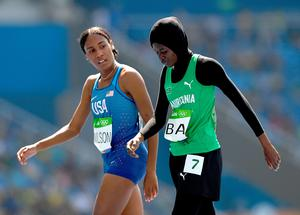 RIO DE JANEIRO, BRAZIL - AUGUST 17:  Ajee Wilson of the United States (L) and Houleye Ba of Mauritania react during the Women's 800m Round 1 heats on Day 12 of the Rio 2016 Olympic Games at the Olympic Stadium on August 17, 2016 in Rio de Janeiro, Brazil.  (Photo by Shaun Botterill/Getty Images)