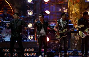 Bruno Mars (2nd left) on stage during the 2014 Brit Awards at the O2 Arena, London
