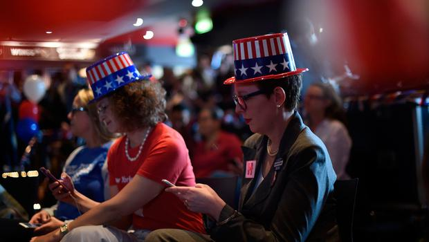 People watch the US election results live at the Sydney University on November 9, 2016.   Australian stocks climbed 0.80 percent at the open Wednesday in anticipation of a victory for Hillary Clinton in the US presidential election. / AFP PHOTO / SAEED KHANSAEED KHAN/AFP/Getty Images