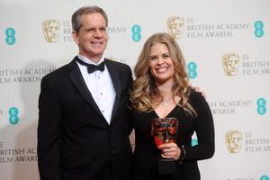 LONDON, ENGLAND - FEBRUARY 16: Jennifer Lee and Chris Buck, winner of the Best Animated Film award, pose in the winners room at the EE British Academy Film Awards 2014 at The Royal Opera House on February 16, 2014 in London, England.  (Photo by Anthony Harvey/Getty Images)