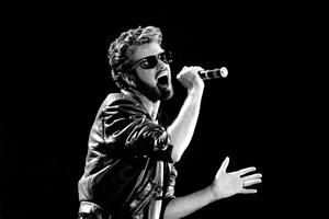 George Michael of Wham performing at the Live Aid concert at Wembley Stadium in London, as the pop superstar has died at the age of 53 from suspected heart failure.