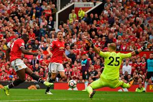 Red hot: Romelu Lukaku scores as another Man United new boy, Nemanja Matic, looks on during the opening victory