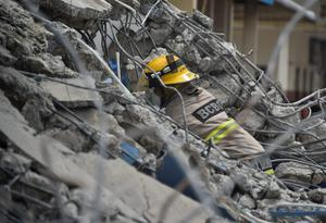 Rescue workers search the rubble after a 7.8-magnitude quake in Gauyaquil, Ecuador on April 17, 2016.  At least 235 people were killed when a powerful earthquake struck Ecuador, destroying buildings and a bridge and sending terrified residents scrambling from their homes, authorities said Sunday. / AFP PHOTO / LUIS ACOSTALUIS ACOSTA/AFP/Getty Images