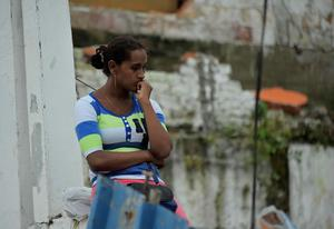 A girl waits in Pedernales, Ecuador, on April 17, 2016 a day after a 7.8-magnitude quake hit the country. Rescuers in Ecuador raced to dig out victims trapped under the rubble of homes and hotels on Sunday after a powerful 7.8-magnitude earthquake killed at least 246. / AFP PHOTO / RODRIGO BUENDIARODRIGO BUENDIA/AFP/Getty Images